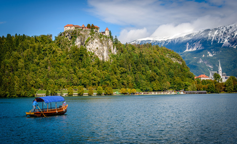 Pletna boat under Bled Castle