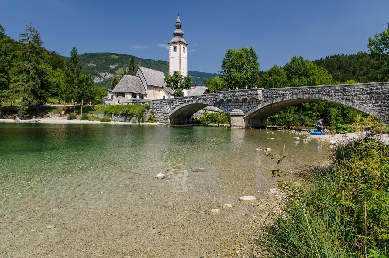 The scenic bridge and church on Lake Bohinj.