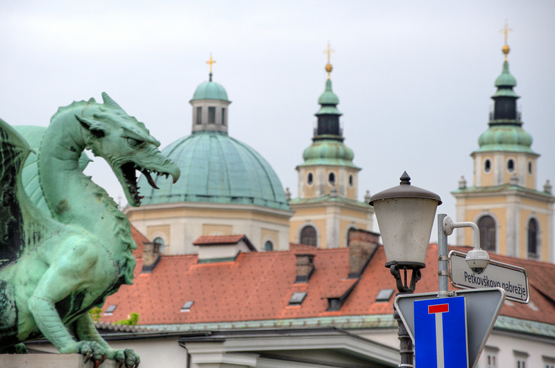 Dragon statue and dome and towers of Ljubljana Cathedral - Slovenia
