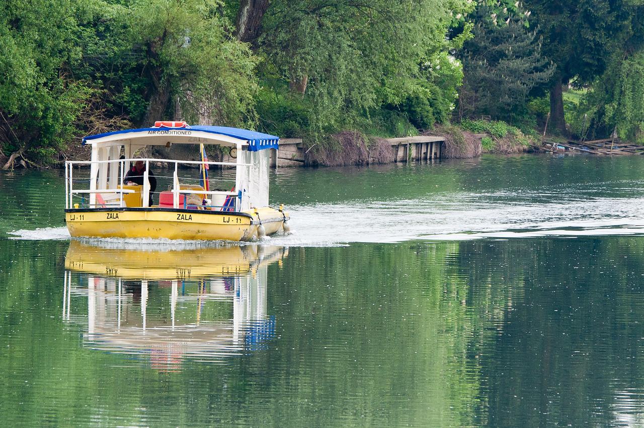 Boat cruising the Ljubljanica River in Slovenia