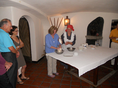 Carrie mixing dough while Jacqui and Ron look on.