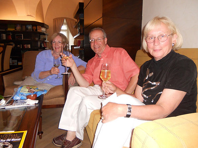Carrie, Paul and Dianne enjoying champagne before dinner at the Hotel Schloss Velden.