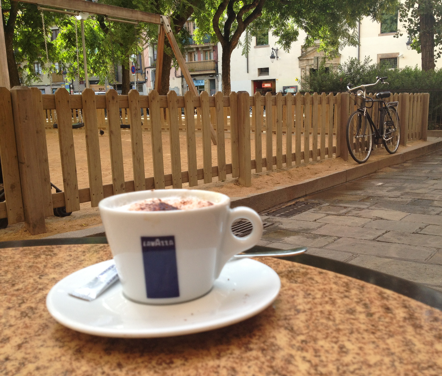 Cofee on a table at an outdoor cafe in Barcelona.