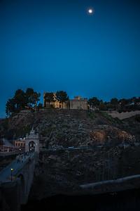 moon above Albergue Castillo San Servando with Puente de Alcantara