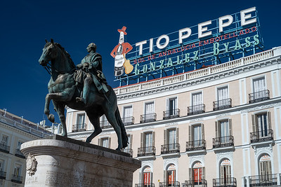 King Carlos statue & Tio Pepe sign Puerta del Sol
