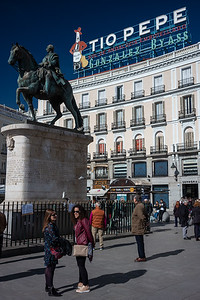 passersby statue and Tio Pepe sign Puerta del Sol