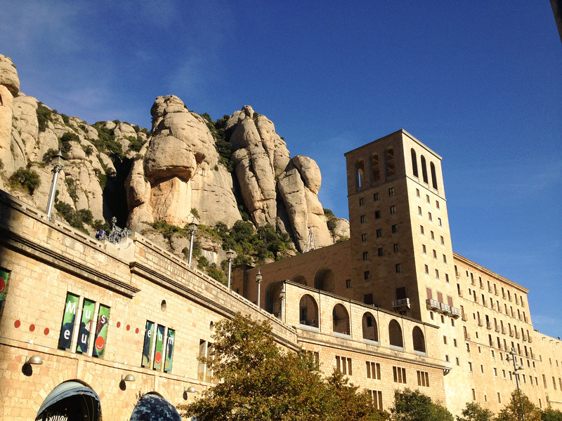 Rock formations loom over the museum and other abbey buildings in Montserrat.