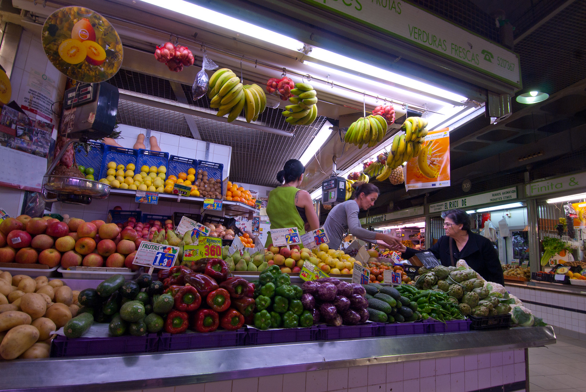 Buying fruit at the market, Alicante, Spain