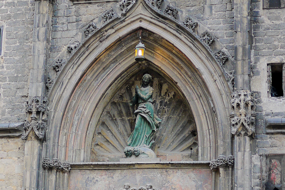 Delicate statues and carvings on the churches of Barcelona, Spain.