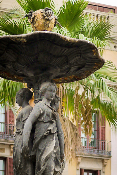 A pretty fountain in a courtyard of the Plaza Real in Barcelona, Spain.