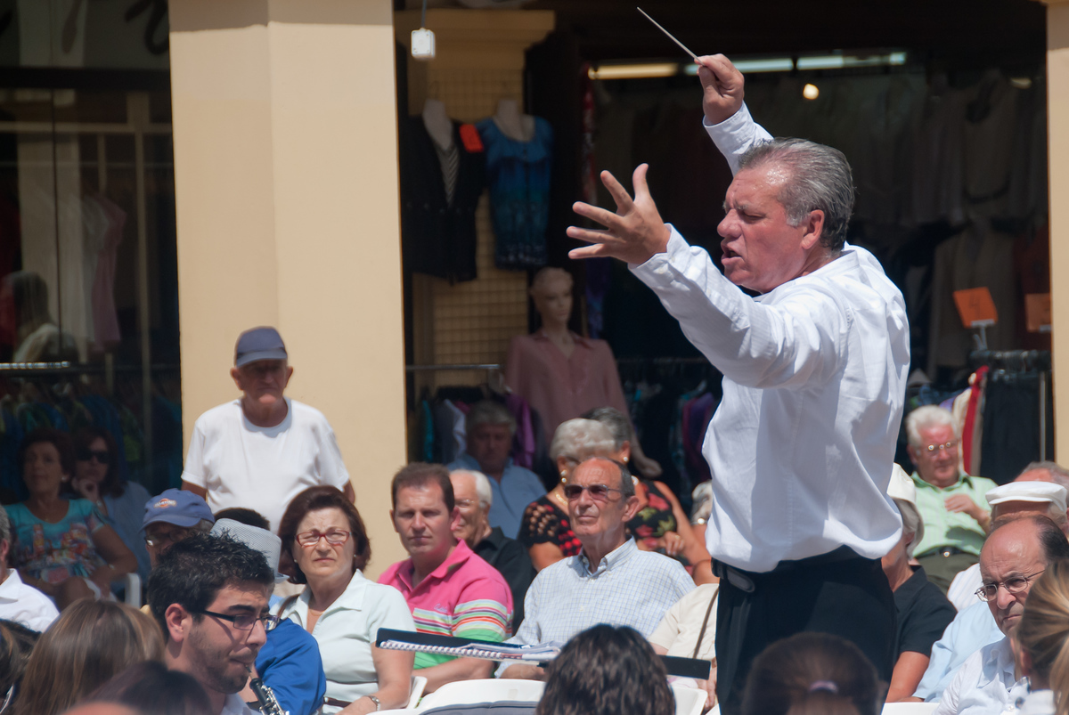 Conducting in the public square, Benidorm, Spain