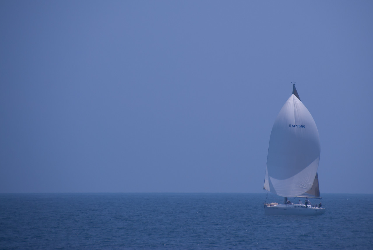 Sail boat cruising on the ocean off the coast of Benidorm in Spain
