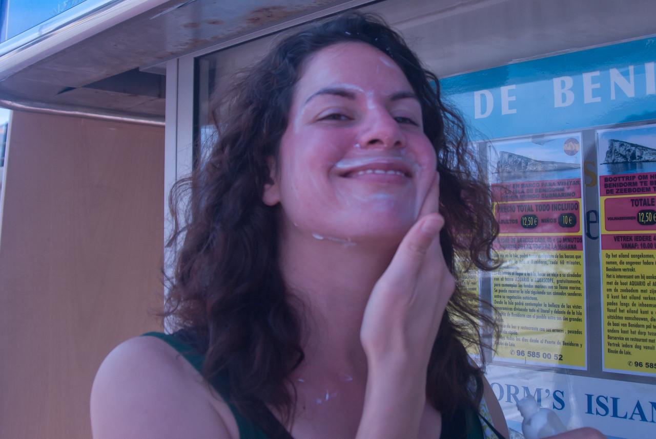 Applying sunscreen while in Benidorm, Spain