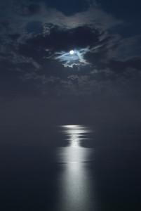 Moonlight reflection on the ocean in Benidorm, Spain