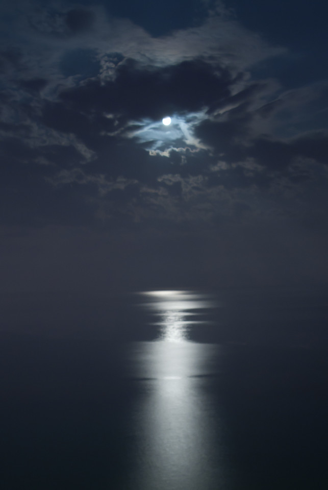 Moonlight reflection on the ocean in Benidorm, Spain
