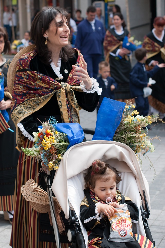 Mother and child participating in Roman Catholic ceremony in Benidorm, Spain