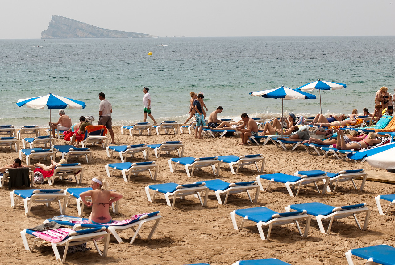 Loungers all over the beach in Benidorm, Spain