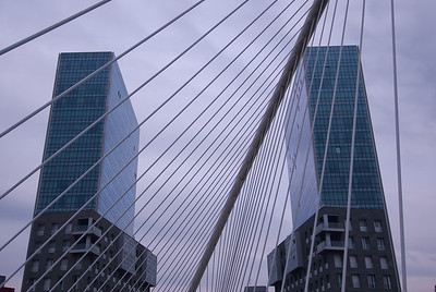 Buildings and arches in Zubizuri Bridge in Bilbao, Spain