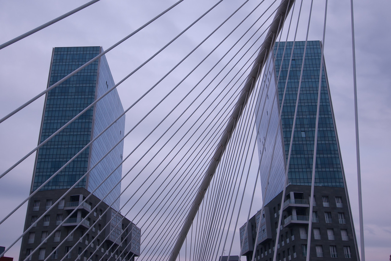 Buildings and arches in Zubizuri Bridge in Bilbao, Spain