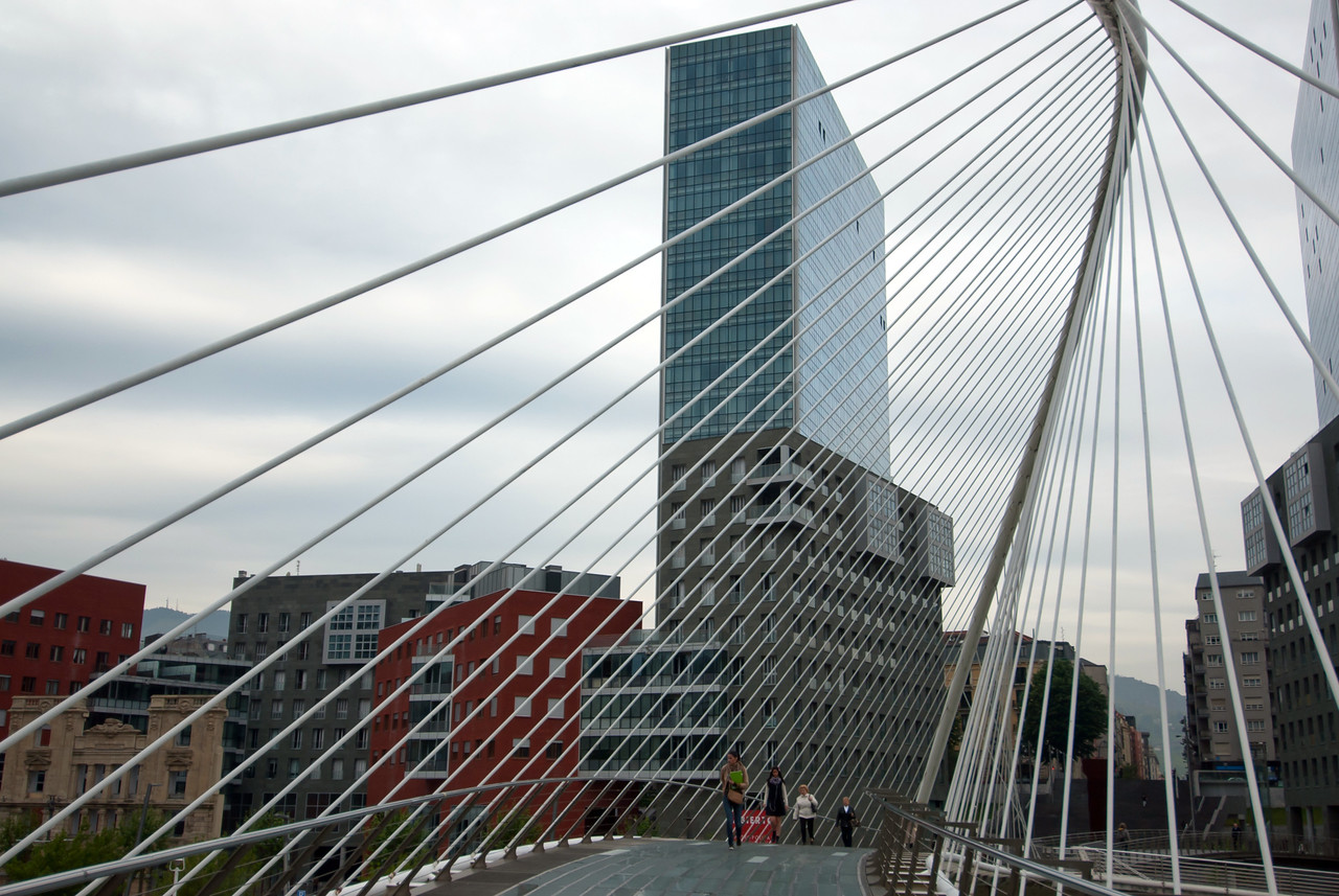 Walking through the Zubizuri Bridge in Bilbao, Spain