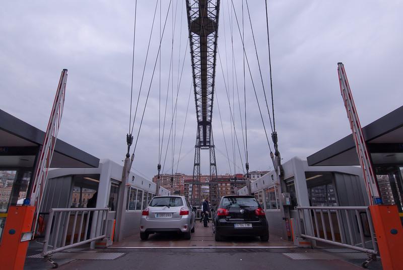 Vehicles loading into Puente Colgante in Bilbao, Spain