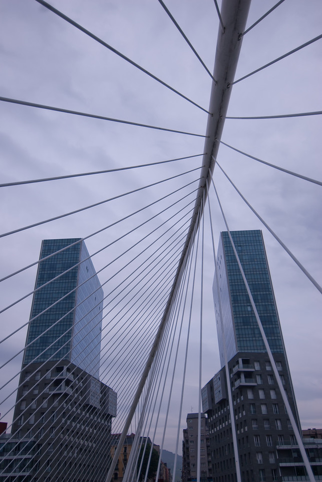 View of high rise buildings from Zubizuri Bridge in Bilbao, Spain