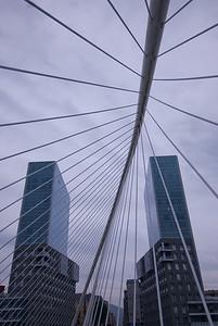 View of high rise buildings from Zubizuri Bridge in Bilbao, Spain