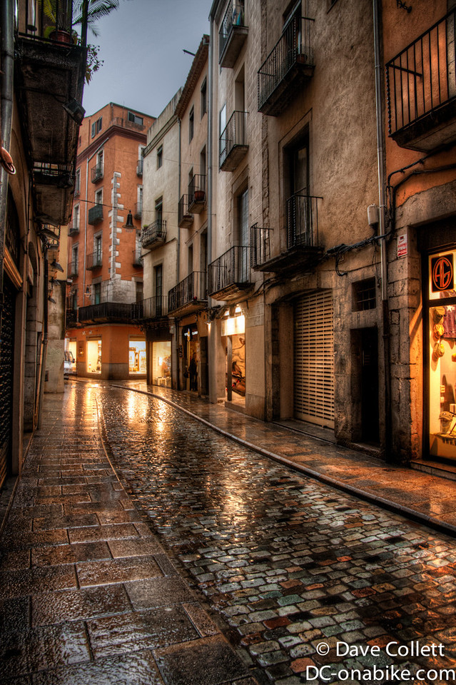 HDR of the narrow wet city street