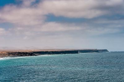 Rocky cliffs near El Cotillo beach in Fuerteventura, Spain