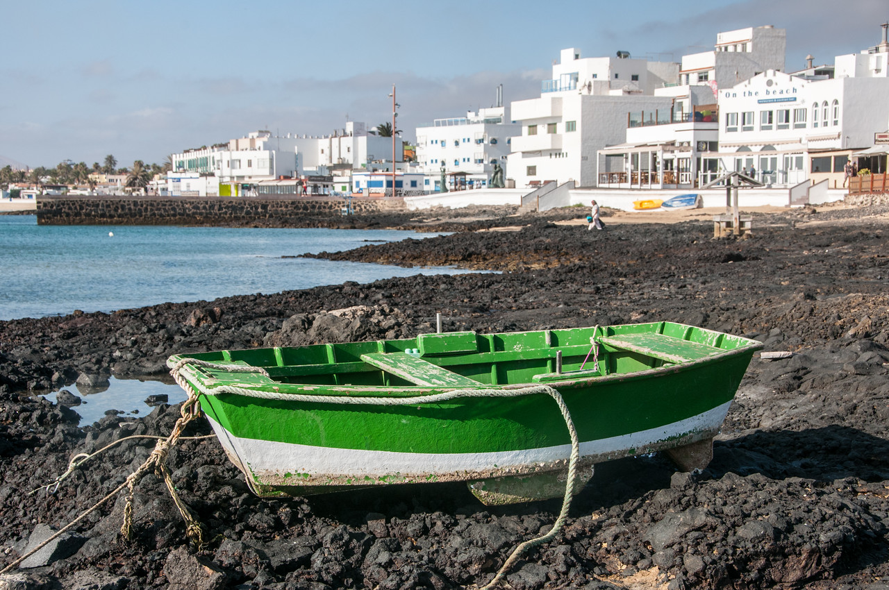 Close-up of boat on rocky beach in Corralejo, Fuerteventura, Spain