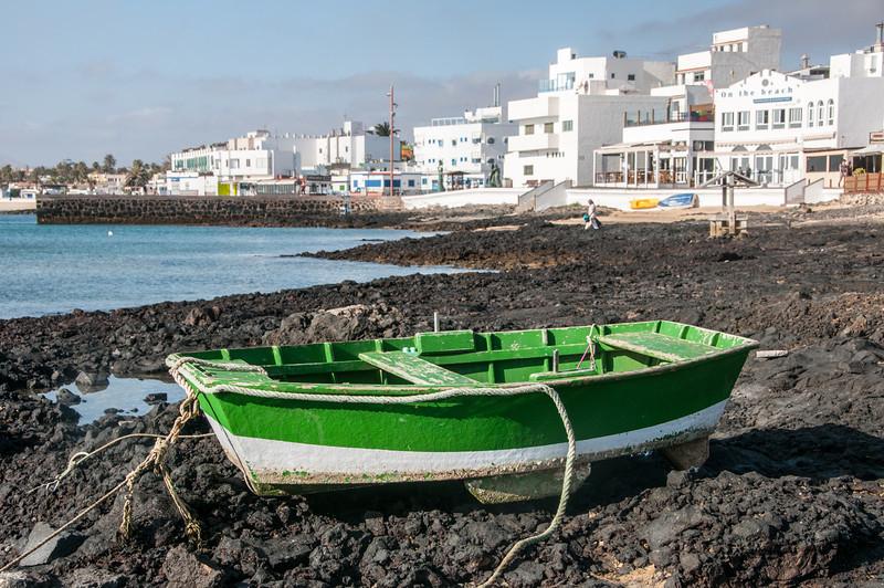 Close-up of boat on rocky beach in Corralejo, Fuerteventura, Spain