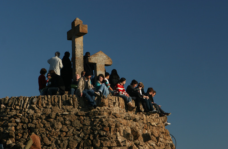 Tourists piled up on the three crosses atop Park Güell.
