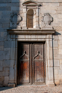 Aged wooden door in Girona, Catalonia, Spain