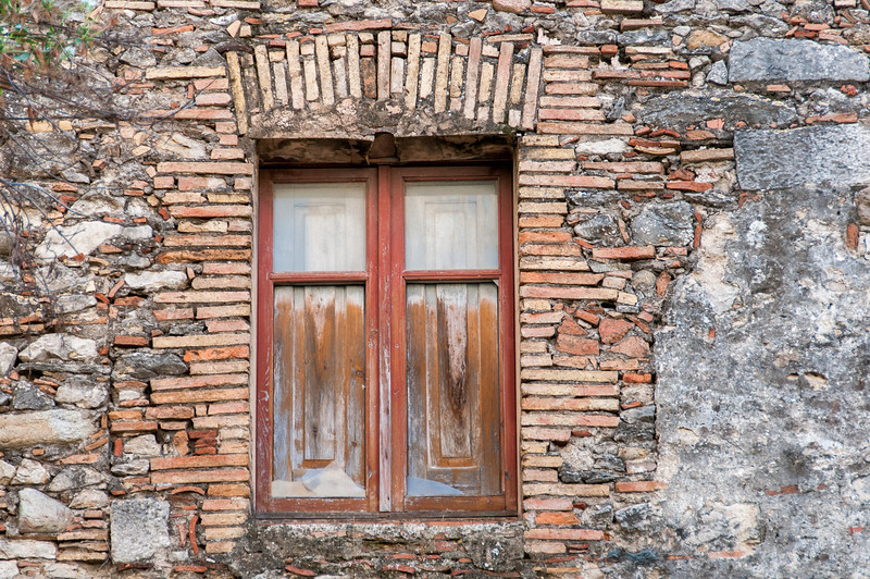 Wooden window in an old building in Girona, Spain