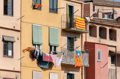 Clothes hung to dry at a building near Onyar River - Girona, Spain