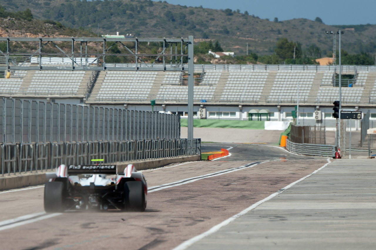 Race car speeding onto the track - Valencia, Spain