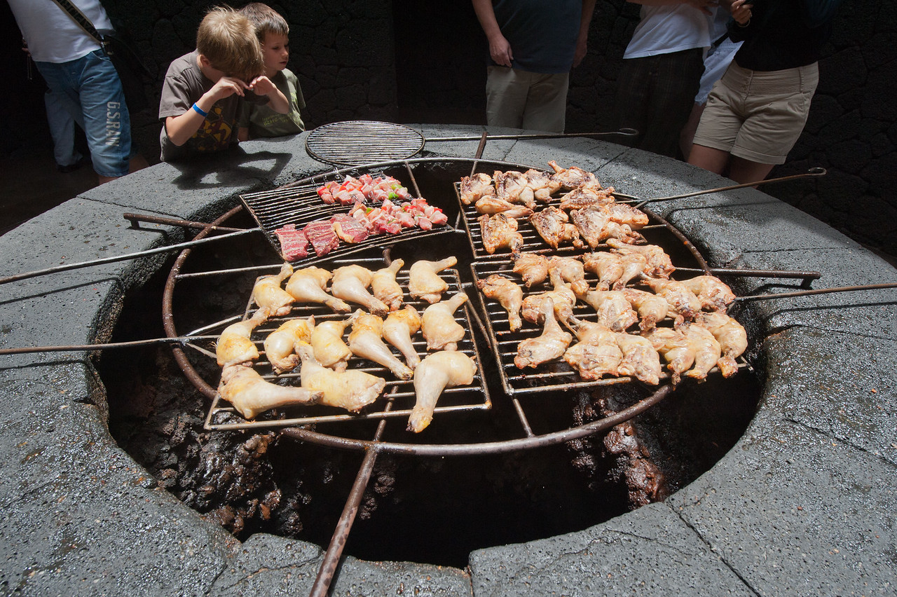 Various meat grilled with volcanic steam in Lanzarote, Spain