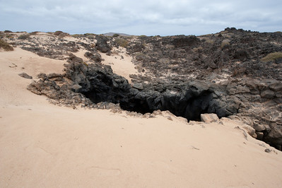 Path leading to the small natural land bridge in La Graciosa, Spain