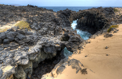 The small natural land bridge in La Graciosa, Spain