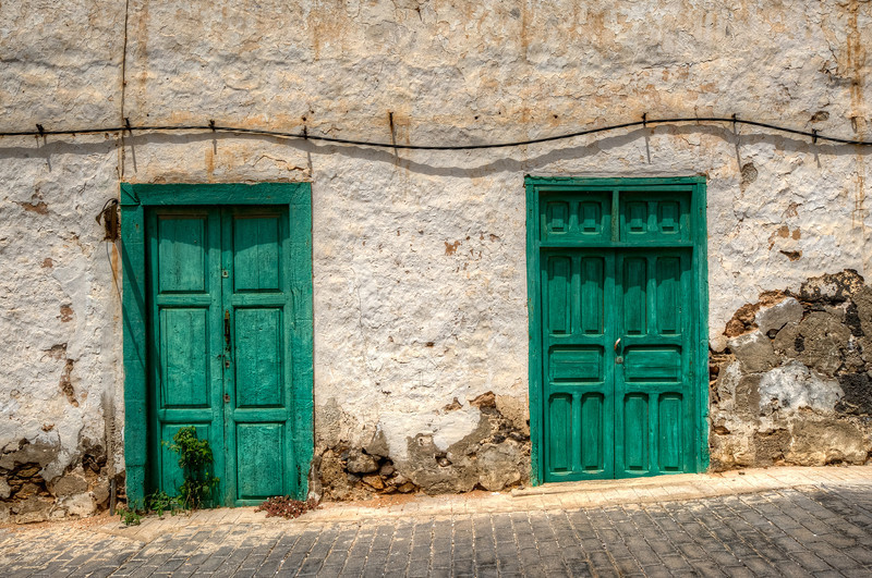 Green doors at a building in Teguise, Lanzarote Island, Spain