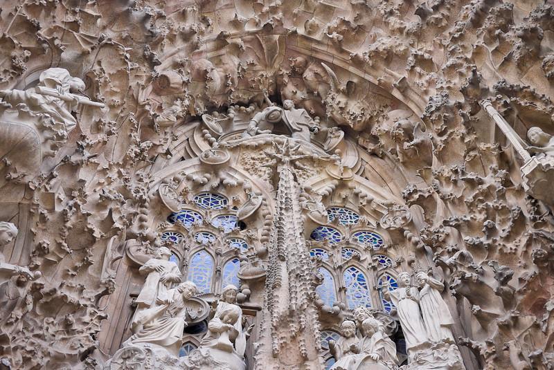 The inctricate Nativity façade on the East side of La Sagrada Familia in Barcelona, Spain