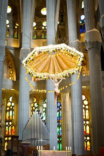 Christ on the alter of the interior of La Sagrada Familia in Barcelona, Spain