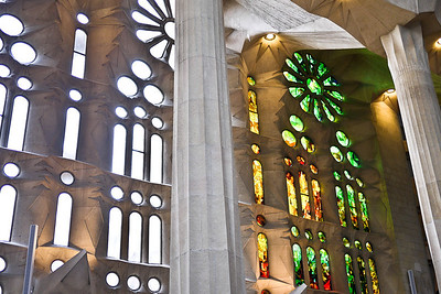 Finished and unfinished windows next to each other inside La Sagrada Familia in Barcelona, Spain