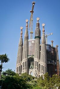 La Sagrada Familia in Barcelona, Spain in the bright afternoon sunlight.