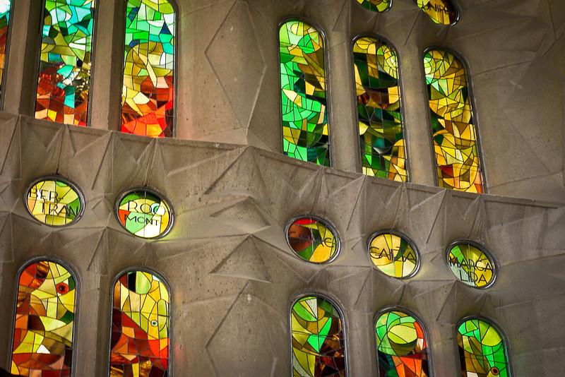 A wall of stained glass in La Sagrada Familia in Barcelona, Spain