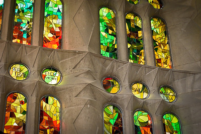 A wall of stained glass in La Sagrada Familia in Barcelona, Spain