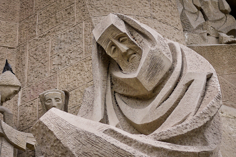 Stark figures on the Passion façade to the West on La Sagrada Familia in Barcelona, Spain