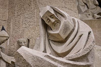 Stark figures on the Passion façade to the West on La Sagrada Familia in Barcelona, Spain