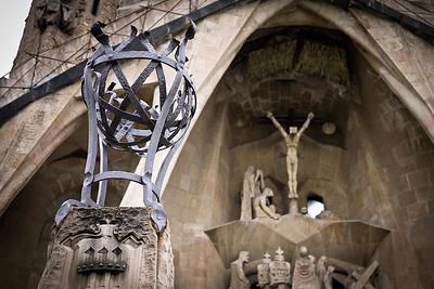 Christ on the cross on the Passion façade of La Sagrada Familia in Barcelona, Spain.
