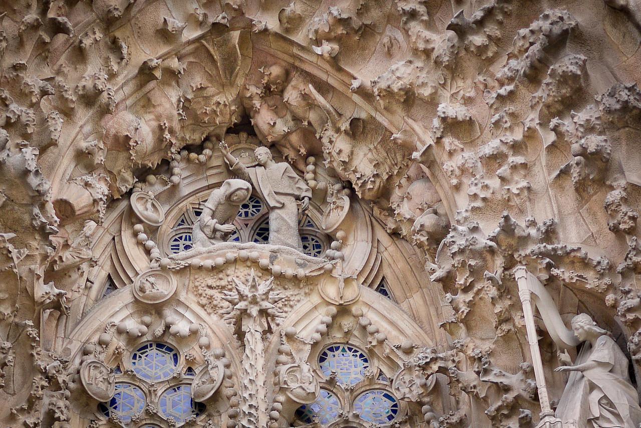 The intricate Nativity façade on the East side of La Sagrada Familia in Barcelona, Spain